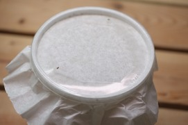 a normal deli cup lid with the center cut out for ventilation